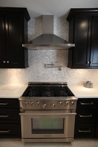 Great stove with a hot water tap installed. Custom built and stained cabinets